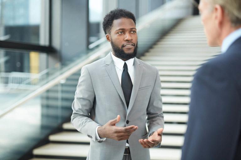 modern-black-businessman-saying-something-min