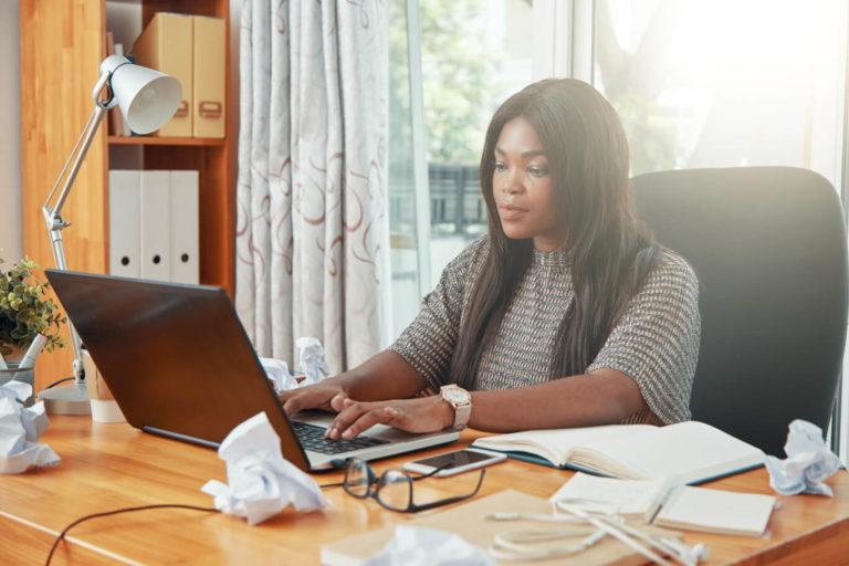 modern-black-businesswoman-working-on-laptop-min